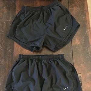 Two Black Nike Dri-Fit shorts